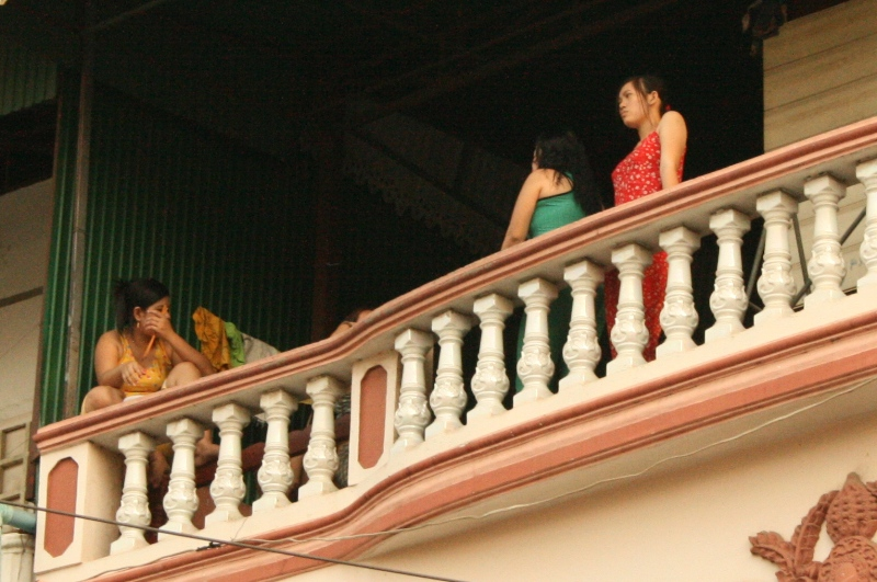 Teenage girls wait for customers at a brothel in Phnom Penh, Cambodia